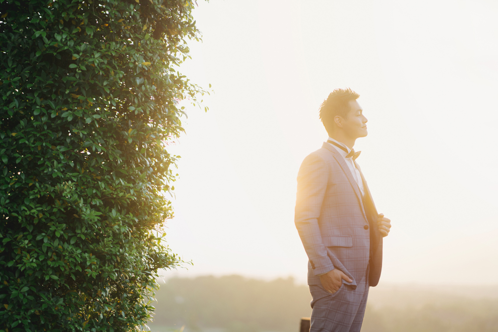 groom alone with beautiful sunlight